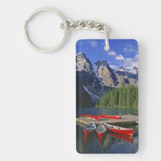Canada, Alberta, Moraine Lake. Red canoes await Keychain