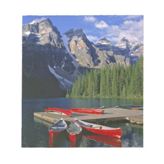 Canada, Alberta, Moraine Lake. Red canoes await Scratch Pad