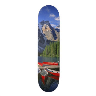 Canada, Alberta, Moraine Lake. Red canoes await Skateboard