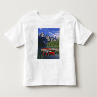 Canada, Alberta, Moraine Lake. Red canoes await Toddler T-shirt