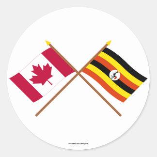 Canada and Uganda Crossed Flags Classic Round Sticker
