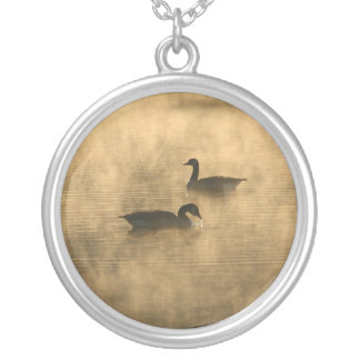 canada geese on the river by sunrise round pendant necklace