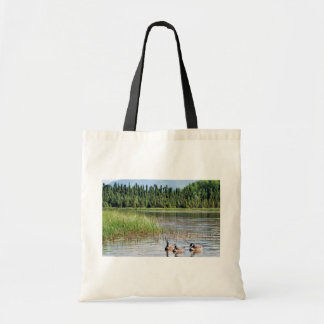Canada goose trio on Goose Lake, Anchorage Tote Bags