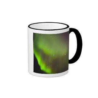 Canada, Manitoba, Churchill. Aurora Borealis in Coffee Mugs