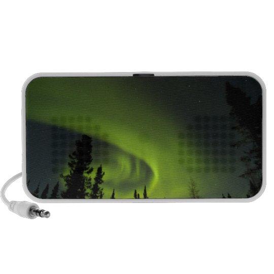 Canada, Manitoba. View of aurora borealis and Portable Speaker