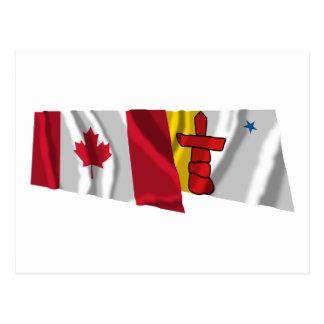 Canadá y banderas que agitan de Nunavut Postal