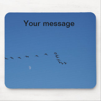 Canadian geese in flight mouse pad