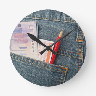 Canadian money and lottery betting slip round clock