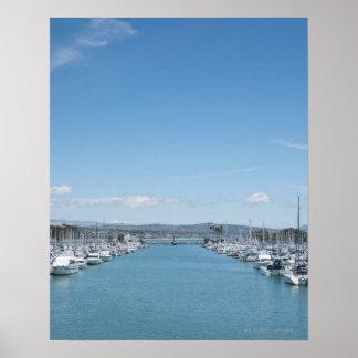 canal en puerto en un día soleado con el cielo azu posters