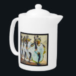"""Cancan Dancers Teapot<br><div class=""""desc"""">Medium white Porcelain teapot with a vintage image, on both sides, of cancan dancers twirling white petticoats under yellow skirts and wearing black stockings, black chokers, and wide-brim feathered hats. See matching candy jar, espresso cup, flask, pitcher, Melamine plate, Porcelain plate, paper plate, shot glass and coasters. See the entire...</div>"""