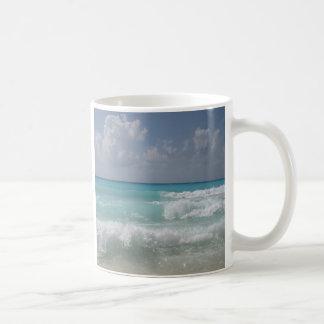 Cancun agita la taza de café