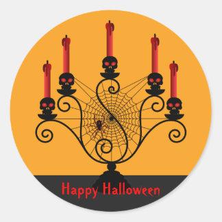 Candelabros del cráneo de Halloween y pegatinas de Pegatina Redonda