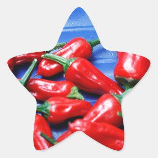 Candente y azul: pimientas de chiles pegatina en forma de estrella