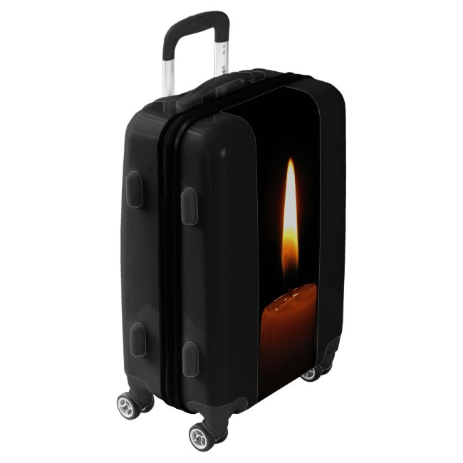 Candle Flame on Black Luggage
