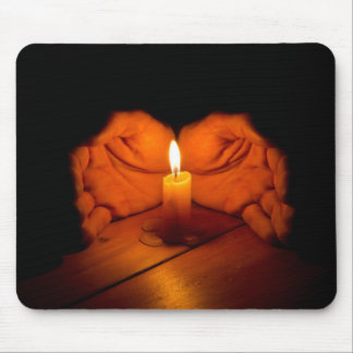 Candle, hands, flame, wood. mouse pad