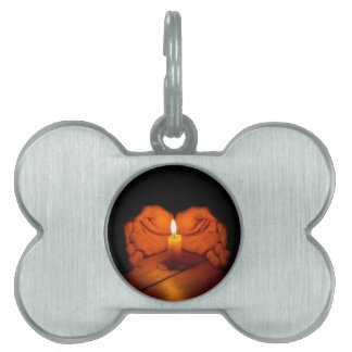 Candle, hands, flame, wood. pet name tag