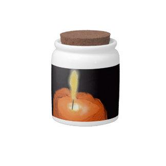 candle melting candy jars