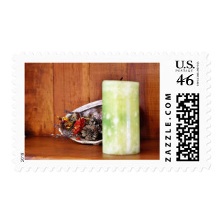 Candle On A Shelf With Some Pinecones And Stuff In Postage Stamps