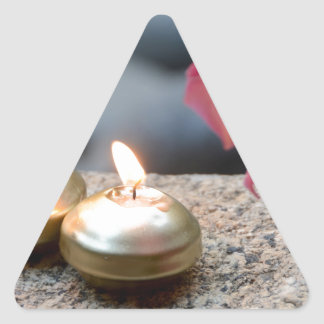 Candles and Water Triangle Sticker