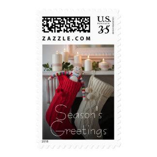 Candles lit on mantelpiece with Christmas Postage