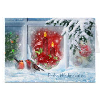 Candles, poinsettias, robins and German Christmas Card