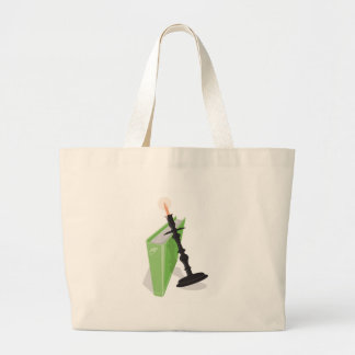 Candlestick holder and a green book tote bags