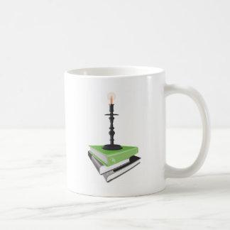 Candlestick holder on books coffee mug