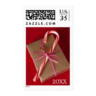 Candy can on top of Christmas gift Postage