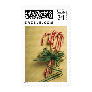 Candy canes tied with ribbon postage