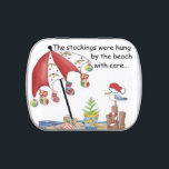"""Candy tin with Christmas in the south at the beach<br><div class=""""desc"""">If you live in the south,  Christmas may look more like this picture - stockings hung from a beach umbrella along the water&#39;s edge,  a small Christmas tree planted in a beach bucket,  Christmas flip flops under the umbrella,  and a Santa hat wearing sea gull looking on.</div>"""