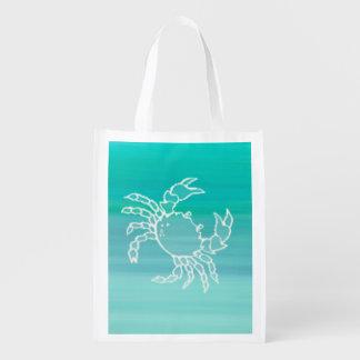 Cangrejo en el océano coloreado aquamarine bolsas para la compra