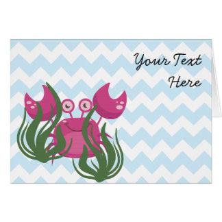 Cangrejo rosado que mira a escondidas a través de tarjeta de felicitación