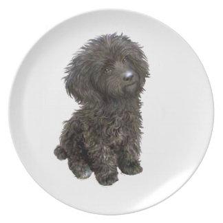 Caniche - perrito negro del juguete plato de comida