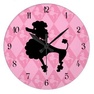 Caniche rosado retro reloj