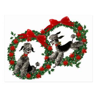 Caniches retros del navidad en guirnaldas postales