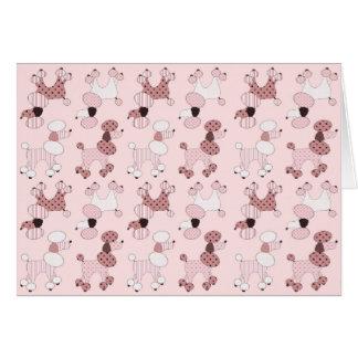 Caniches rosados en tarjeta del desfile