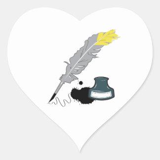 Canilla y tinta pegatina en forma de corazón