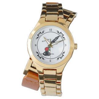 Canilla y tinta subiós alrededor del oro del reloj