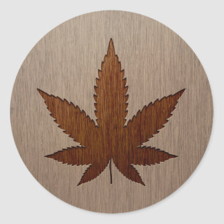 Cannabis leaf engraved on wood design classic round sticker