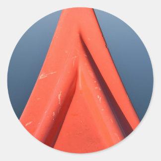 Canoa roja pegatina redonda