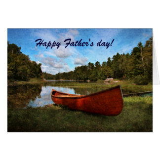 Canoa rústica roja en el banco del lago tarjetas