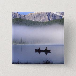 Canoe fishing Waterfowl Lake, Banff National Button