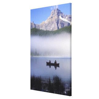 Canoe fishing Waterfowl Lake, Banff National Canvas Print