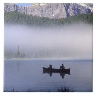 Canoe fishing Waterfowl Lake, Banff National Tile