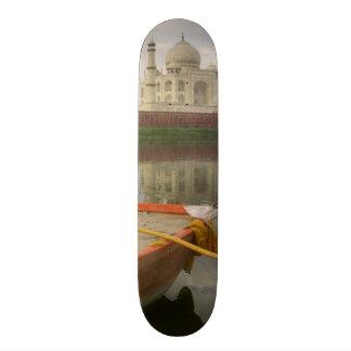 Canoe in water with Taj Mahal, Agra, India Skateboard Deck