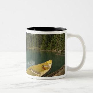 Canoe parked at a dock along Moraine Lake Banff Mug
