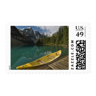 Canoe parked at a dock along Moraine Lake, Banff Stamp