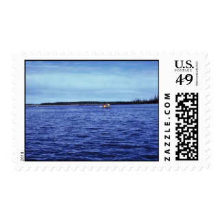 Canoeing at mouth of Sheenjek River at the Porcupi Stamps