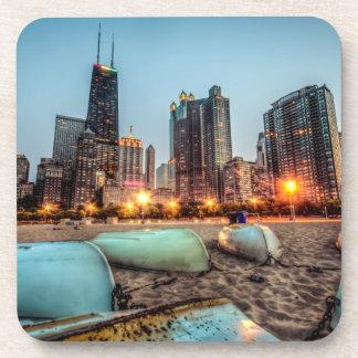 Canoes on Oak Street Beach a little after sunset Coaster