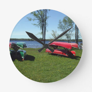 Canoes on Shore Round Clock